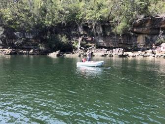 Tying stern to rocks in Pinta Bay