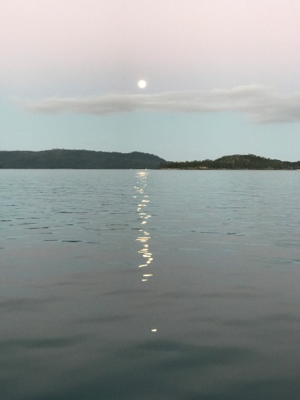Moon rise over a glassy sea